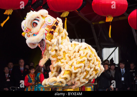 Chinese Lion acrobatics at Trafalgar Square during London's celebrations of the Chinese New year. England. - Stock Photo