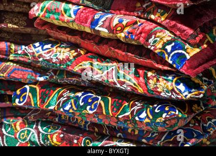 Velvet cushions for sale on a stall outside Chorsu Bazaar, Tashkent, Uzbekistan - Stock Photo