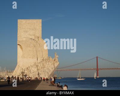 Padrão dos Descobrimentos and the 25th April bridge in Lisbon - Stock Photo