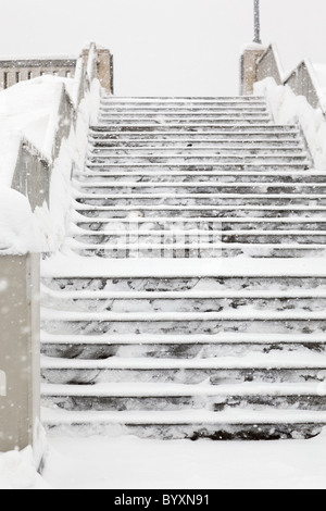 Concrete stairs covered in snow, Winnipeg, Manitoba, Canada. - Stock Photo