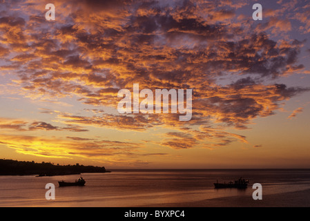 Dramtic clouds and boats in the Bahia Valparaiso at unset over historical port and city of Valparaiso- Chile - Stock Photo