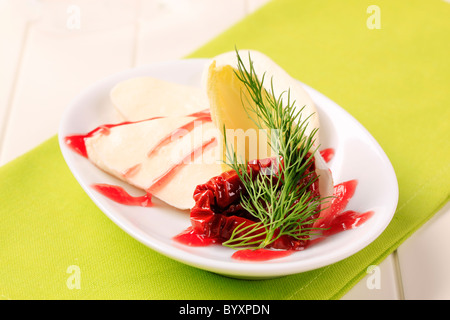 Mozzarella cheese with garnish and raspberry balsamic reduction - Stock Photo