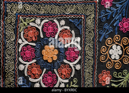 Detail of embroidered textile for sale at market, Khiva, Uzbekistan. Suzani - Stock Photo