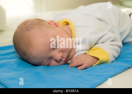 Sleeping 2 month old baby boy. Parent model released - Stock Photo