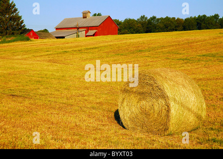 Hay bale on rural property in Catskill region of New York State. - Stock Photo