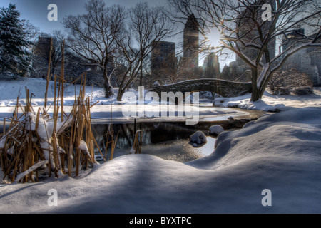 Gapstow Bridge in Central Park the Morning After a Snowstorm - Stock Photo