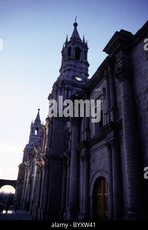 Cathedral on the Plaza de Armas silhouetted at sunset in the colonial city of Arequipa, Peru.  Religious architecture - Stock Photo