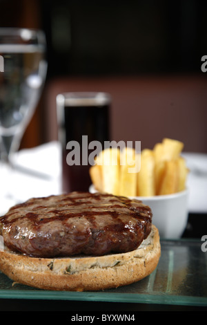 Close up of burger and french fries - Stock Photo