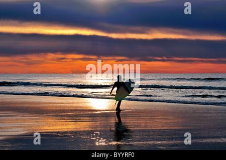 Portugal, Algarve: Surfer at beach Praia do Amado - Stock Photo