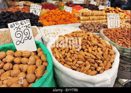 Merchant of nuts and seeds on display in Mahane Yehuda Market is an outdoor marketplace in Jerusalem, Israel. Popular - Stock Photo