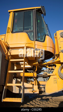Ladders to the Volvo L180F front loader cabin - Stock Photo