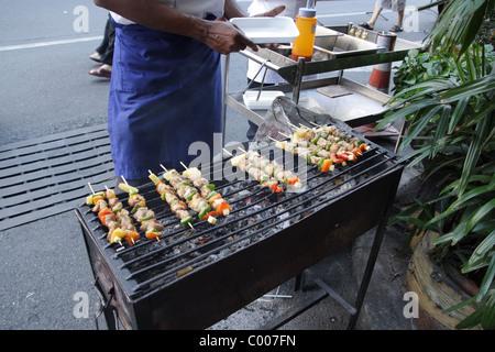 BBQ seller on street in Bangkok - Stock Photo