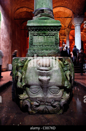 Turkey, Istanbul, the Basilica Cistern, a head of Medusa, turned upside down in one of the hundreds columns. - Stock Photo