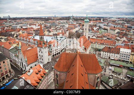 View looking East from tower of Peterskirche with the Old Tow Hall and Heiliggeistkirche, Marienplatz, Munich, Germany - Stock Photo