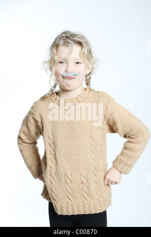 A blond girl with a grey moustache stuck on, hands on hips and looking cross - Stock Photo