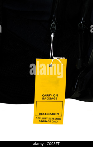 Airport security tag put on a carry on baggage - Stock Photo