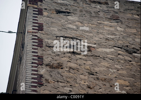 Brick Wall, Paris, France, Old Stone Façade, Building, Showing Water damages - Stock Photo