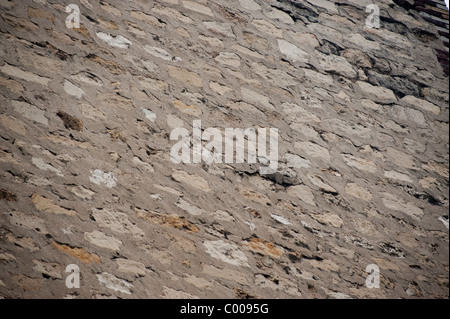 Old Stone Façade Wall, Building, Showing damages - Stock Photo