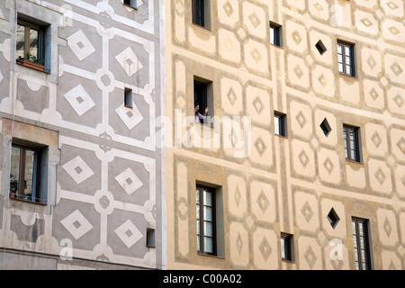 Girl Waving from Window from Facade on Santa Maria del Mar Square, Barcelona, Catalonia, Spain - Stock Photo