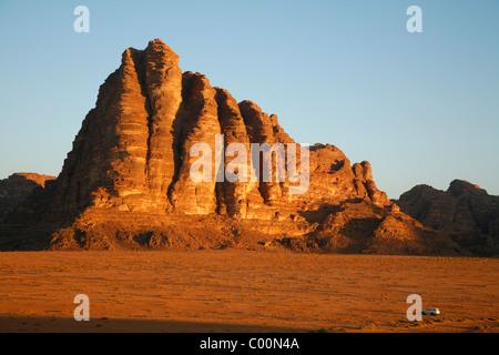 The Seven Pillars of Wisdom rock formation, Wadi Rum, Jordan. - Stock Photo