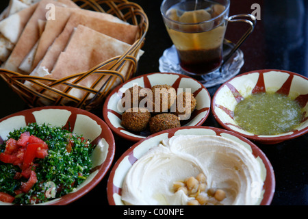 Typical breakfast of hummus, falafel salad and pita bread, Aqaba, Jordan. - Stock Photo