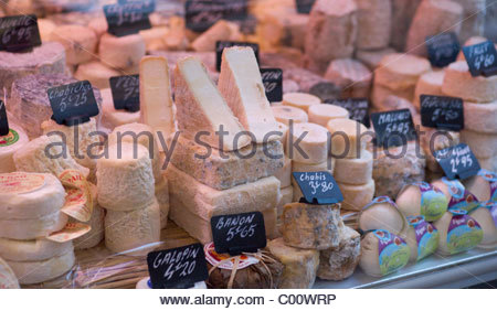 Various cheeses for sale Paris France - Stock Photo