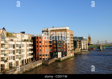 apartment buildings on the thames river in london uk stock photo royalty free image 112650300. Black Bedroom Furniture Sets. Home Design Ideas