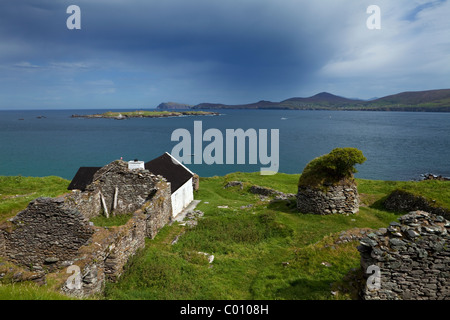Restored and Evacuated Cottages on Great Blasket Island, Blasket Islands, Dingle Peninsula, County Kerry, Ireland - Stock Photo