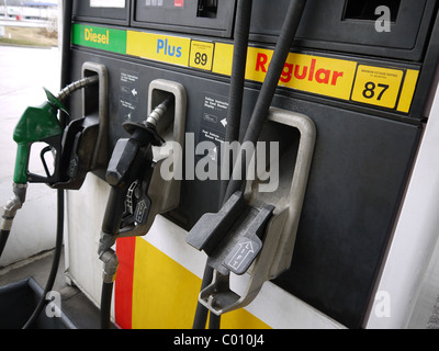 Close-up of gas pump nozzles at a gas station. - Stock Photo