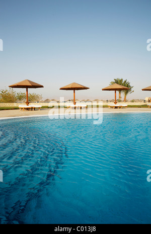 Pool with a blue water surface, sun lounges and sunshades, Soma Bay, Red Sea, Egypt, Africa - Stock Photo
