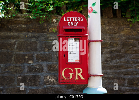 Post box on decorated lamp post - Stock Photo