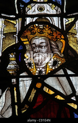 A 16th century stained glass window depicting a king, possibly St Edmund or St Edward Confessor, Battlefield Church, - Stock Photo