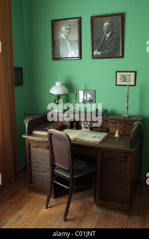 Classic desk with appliances like chair, lamp etc. Shot in manor house in Janowiec (lubelskie), Poland. - Stock Photo