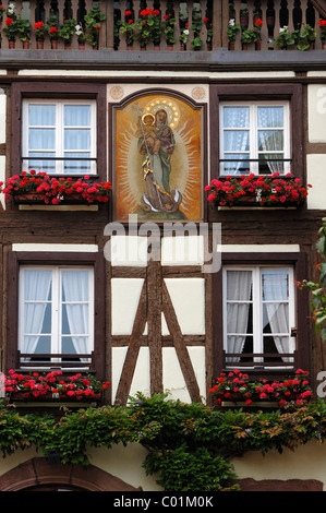 Image of the Virgin Mary on the facade of Maison Loewert, 16th century, rue du Général de Gaulle, Kaysersberg, Alsace, - Stock Photo