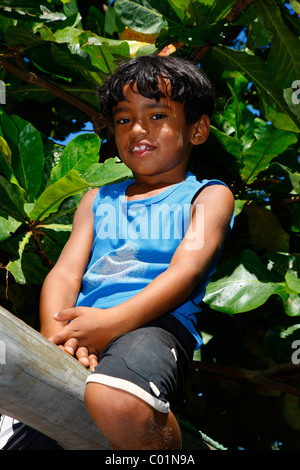 Boy sitting on the monkey bars, Fortaleza, Ceará, Brazil, South America - Stock Photo