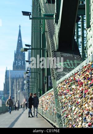 Love Locks on the Hohenzollern Bridge in Cologne - Stock Photo