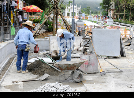 Construction workers doing road construction, Hong Kong, China, Asia - Stock Photo
