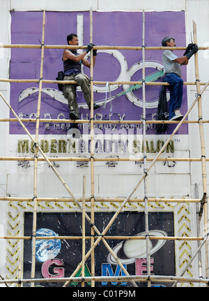 Workers on a scaffold made of bamboo, Hong Kong, China, Asia - Stock Photo