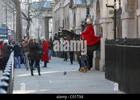 people watching the Queen's Life Guards in Whitehall, London - Stock Photo