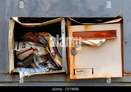 Damaged mailboxes full of advertising, Guémar, Alsace, France, Europe - Stock Photo