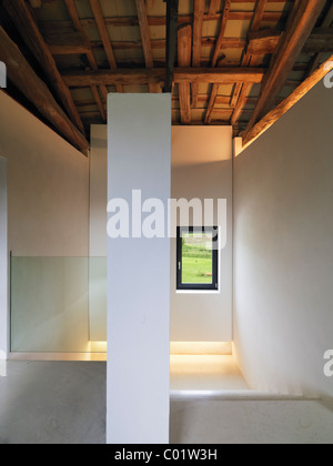 staircase in attic with glass banister and wood ceiling in farmer renovated - Stock Photo