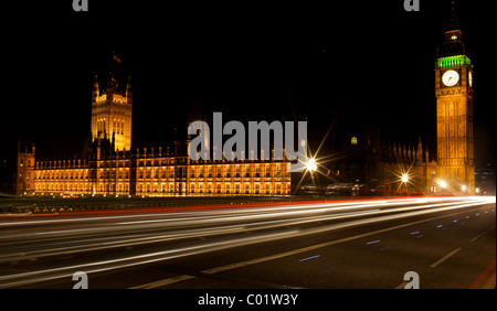 Light trails outside the houses of parliament in London - Stock Photo