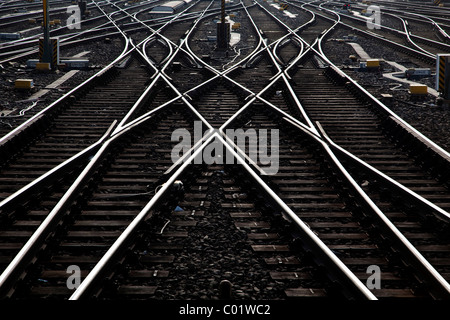 Railway tracks and switches or turnouts of the Deutsche Bahn AG at Frankfurter Hauptbahnhof, Frankfurt's main railway - Stock Photo