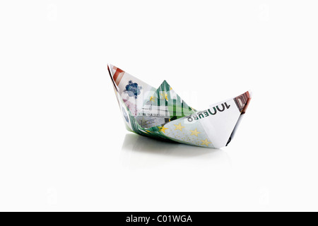 Paper boat from euro notes - Stock Photo