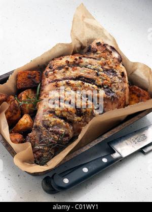 Leg of lamb in a roasting dish - Stock Photo