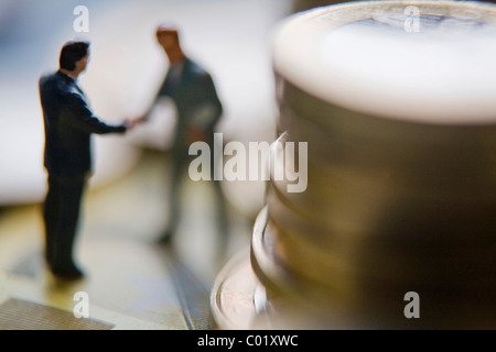 Business men, managers, figures with euro coins - Stock Photo