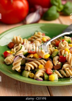 Individual portion of vegetarian spelt pasta salad - Stock Photo