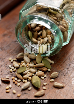 Glass bottle with various seeds - Stock Photo