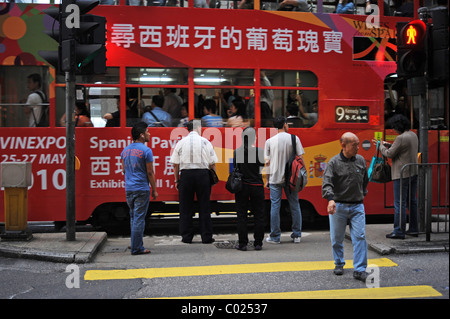 People at a zebra crossing, Hong Kong, Asia - Stock Photo