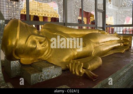 sleeping Buddha statue at Shwezigon Pagoda, Nyaung Oo, Bagan, Burma Myanmar - Stock Photo